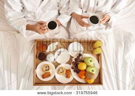 Everything. Right, Where You Need It. Couple Relaxing In Hotel Room Wearing Robes