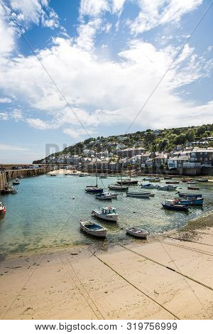 Mousehole, Cornwall, Uk - July 17, 2019.  The Picturesque Cornish Fishing Village Of Mousehole With