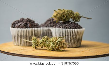 Homemade Cakes With Cannabis And Buds Of Marijuana. Concept Of Using Marijuana In Food Industry.