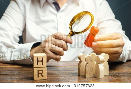 Wooden Blocks With The Word Hr And Businessman With A Crowd Of Workers. Hiring, Hire Concept. Creati