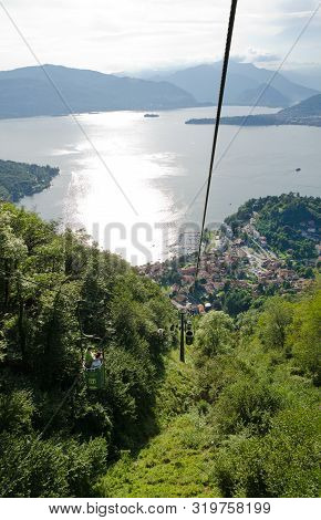 Laveno, Lake Maggiore, Italy. 16th August 2019. Tourists Riding The Bucket-lift Cablecar Up The Moun