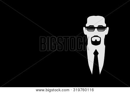 Man In Black Suit And Dark Glasses. Symbol Safety. Bodyguard, Security, Face Control, Bouncer. Isola