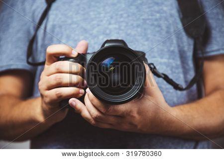 Close Up Of Man Hands Holding Dslr Camera - Man Photograph With Camera