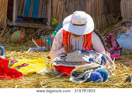 Titicaca Lake Peru, August 16 Woman In Typical Dress Working In One Of The Islands Of Titicaca.. Sho