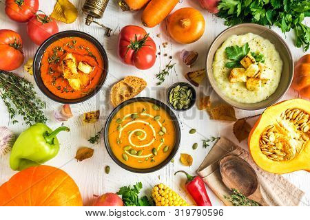 Autumn Soups. Set Of Various Seasonal Vegetable Cream Soups And Organic Ingredients On White Backgro