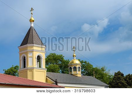 Crosses On The Church Domes Photographed Against The Cloudy Sky