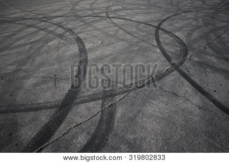 Tire Tracks. Wheel Track On Asphalt Road. Asphalt With Traces Of Car Wheels. Traces Of Braking From