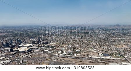 Bird Eye View Of City Of Phoenix Downtown Circled By Distant Mountains And Desert, Arizona