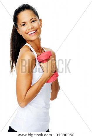 Beautiful happy smiling latino woman do toning exercises with dumbbells in studio