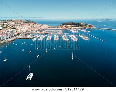 Aerial View Of Boats In Baiona Harbour And Fort