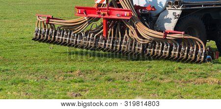Closeup Of A Liquid Manure Injector Fertilizing A Meadow