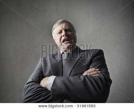 Angry senior businessman quarreling