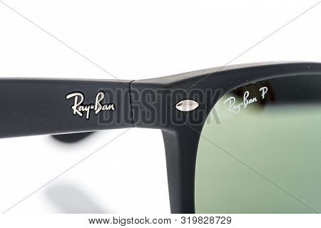 Winneconne, Wi - 28 August 2019 : A Close-up Of Ray Ban Sunglasses By Luxottica On An Isolated Backg