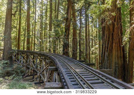 Steam Train Railroad And Trestle Bridge Over Redwoods. Felton, Santa Cruz County, California, Usa.