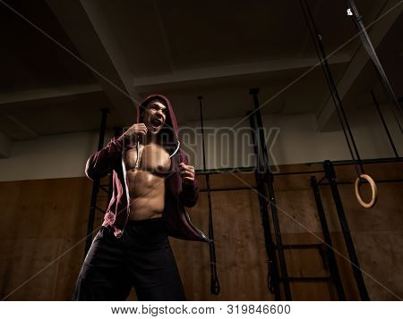 Strong Muscular Fighter Training Hard In Modern Gym