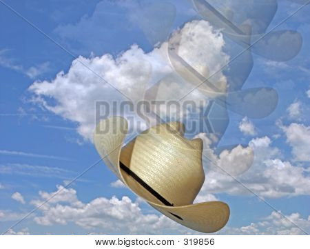 Photo Of Blue Skies And White Clouds And Cowboy Hat Tossed Into
