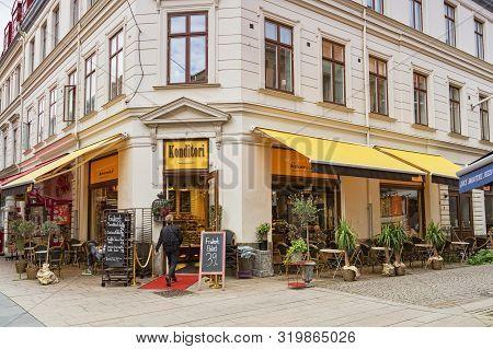 14 September 2018: Gothenburg, Sweden - Woman Entering Konditori Restuarant Or Coffee Shop.