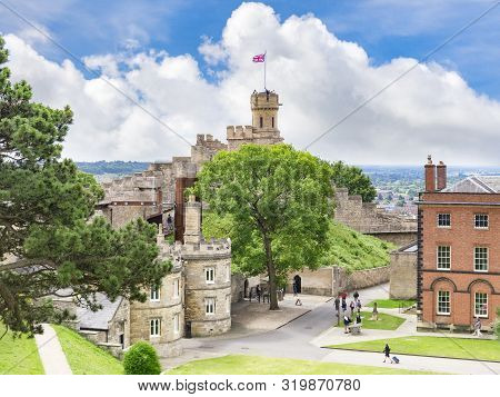 2 July 2019: Lincoln, Uk - The Castle, High Angle View With Distant People Walking Around. The Castl