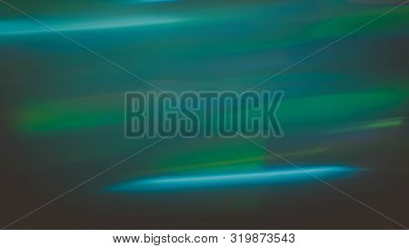 Defocused Lights Leak. Blur Green And Blue Smeared Strokes. Dark Abstract Background.