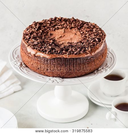 Chocolate Cake On A Cake Stand Decorated With Chocolate Shavings, Square