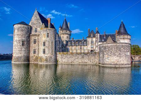 Sully Sur Loire, France - April 13, 2019: Famous Medieval Castle Sully Sur Loire At Sunset, Loire Va