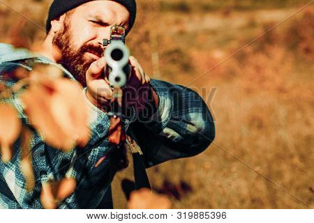 Hunter Man. A Hunter With A Hunting Gun And Hunting Form To Hunt In Forest. Calibers Of Hunting Rifl