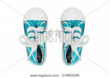 Pair of new casual classic gumshoes blue color with laces and rubber sole for sport isolated on white background. Top view poster