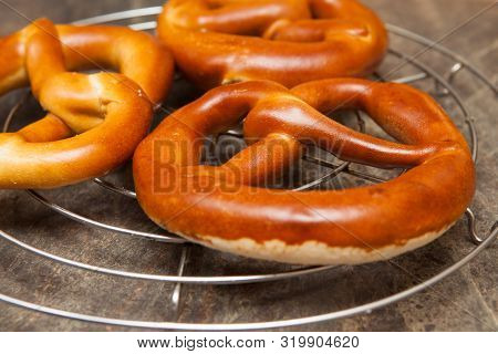 German Style Pretzels Cooling Three German Style Pretzels Cooling On A Wire Rack