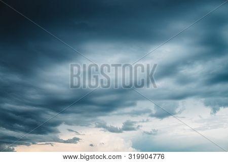 Dramatic Cloudscape. Sunny Light Through Dark Heavy Thunderstorm Clouds Before Rain. Overcast Rainy