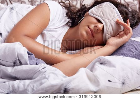 Image Of Young Woman Sleeping With Eye Mask, Lying Under Cosy Blanket In Comfortable Bed At Home, Br