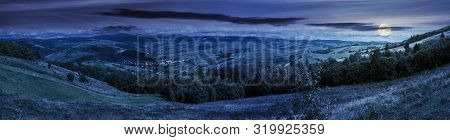 Panorama Of Mountainous Countryside At Night In Full Moon Light. Beautiful Highland Landscape With G