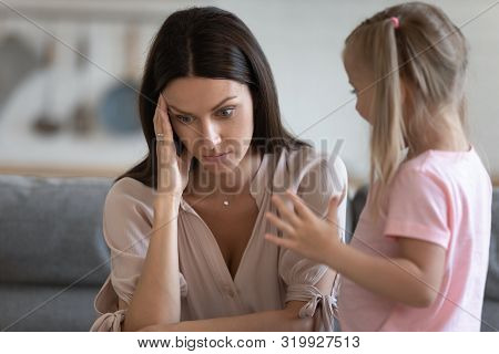 Annoyed Mom And Restless Little Daughter At Home
