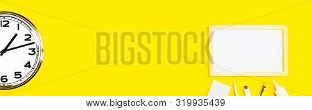 Part Of Wall Clock With Stationery On Yellow Background Banner