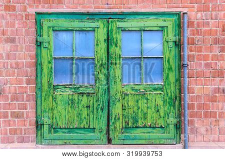 An Old Rotten Door With Green Splintered Paint