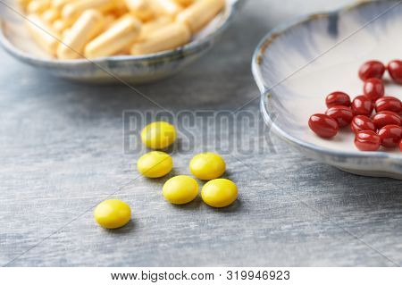 Vitamin C, Beta-carotene Tablets And Coenzyme Q10 Capsules. Antioxidants. Concept For A Healthy Diet