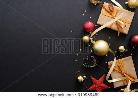 Modern Red And Golden Christmas Decorations, Baubles, Gift Boxes On Dark Black Background. Flat Lay