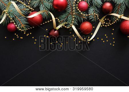 Christmas Dark Black Background With Red Baubles, Christmas Decorations, Fir Tree Branches, Confetti