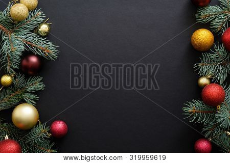 Black Christmas Background With Festive Decorations, Baubles, Fir Tree Branches. Christmas Holiday C
