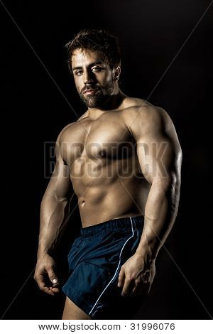 An image of a handsome young muscular sports man poster