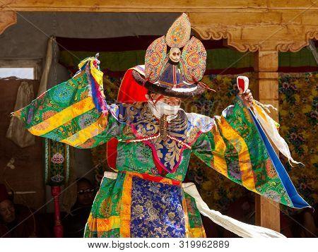 Padum, Zanskar, India - July 17, 2012: Lama In Ritual Costume And Ornate Hat Performs A Historical M