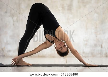 Beautiful Woman Practicing Yoga, Downward Facing Dog, Adho Mukha Svanasana