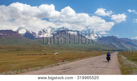 Pamir Highway Or Pamirskij Trakt With Biker. Landscape Around Pamir Highway M41 International Road,