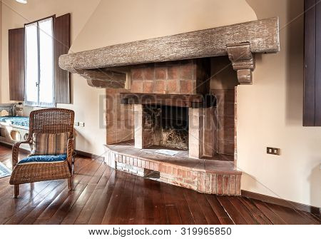 Rustic Brick Fireplace With Wooden Beams.