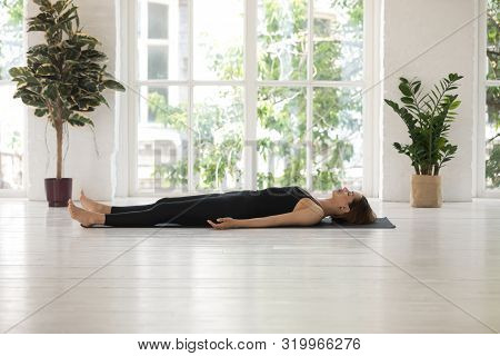 Young Woman Doing Savasana Exercise, Dead Body, Corpse, Practicing Yoga