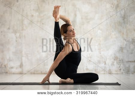 Young Woman Practicing Yoga, Surya Yantrasana Exercise, Compass