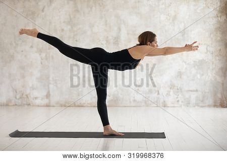 Beautiful Woman Practicing Yoga, Warrior Three, Virabhadrasana Exercise