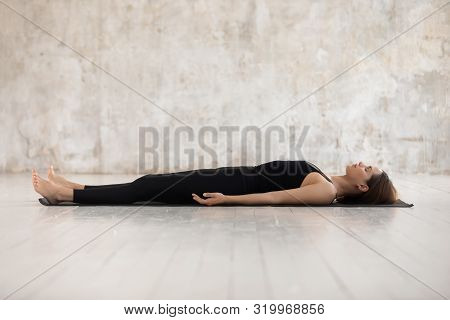 Young Woman Practicing Yoga, Savasana, Dead Body Pose, Corpse