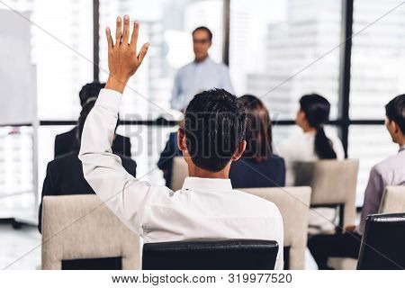 Businessman Standing In Front Of Group Of People In Consulting Meeting Conference Seminar And Showin