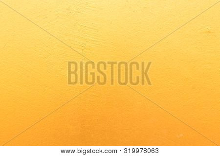 Gold Concrete Background With Light Reflections. Golden Textured Wall.