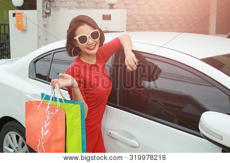 Happy Woman With Shopping Bags Enjoying In Shopping Outdoor.